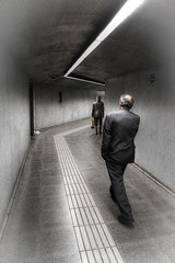 Thru the Tunnel (Robert 'Ferd' Frank) Tags: barcelona vacation people blackandwhite woman man businessman architecture underground walking subway lights spain cityscape time action 1600 photograph stark 2009 hdr highiso traintunnel flickraward seenunderthestreet