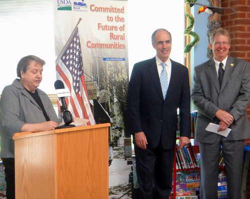 Pittston Memorial Library Director Anne Hogya (left) gives a warm welcome to U.S. Senator Robert Casey (center), and Thomas Williams, USDA Rural Development State Director (right)