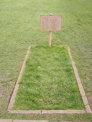 Site of King Arthur's burial (ell brown) Tags: greatbritain england abbey grave plaque ruins unitedkingdom destruction tomb glastonbury somerset holygrail latin skeletons avalon kingarthur mendip glastonburyabbey reformation enscription isleofavalon englishreformation queenguinevere twoskeletons hollowoaktrunk leadencross openplaques:id=8344