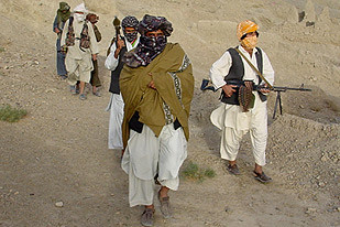 "Taliban units on patrol in Afghanistan. The resistance movement to US/NATO occupation has issued a ""Code of Conduct"" manual. Casualties are mounting among both the Afghan people and the imperialist troops."