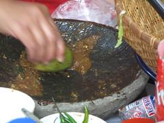 scoop sauce using green mango spoon