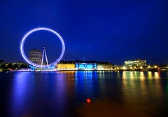 London Eye at Night (5ERG10) Tags: city uk longexposure greatbritain blue england motion reflection london eye water colors westminster sergio wheel yellow thames museum architecture night reflections river lights aquarium evenin
