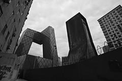 21378_350s (rudenoon) Tags: china bw architecture cn beijing 北京 oma 中国 koolhaas tvcc 朝阳区 建筑学 chaoyangdistrict cctvbuilding cctvbeijing sonydslra350 cctvheadquartersbldg cctvheadquartersbuilding 中央电视台总部大楼 雷姆库哈斯