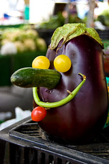 Mister Eggplanthead has a runny nose (dogwelder) Tags: california red food green smile face vegetables yellow purple farmersmarket head eggplant cucumber tomatoes bean zurbulon6 plans calabasas zurbulon