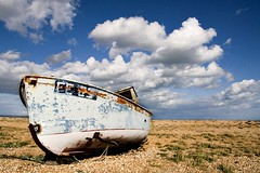 Bleached (woolyboy) Tags: uk beach boat kent shingle dungeness whitefluffyclouds woolyboy fe25