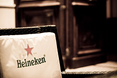 probably the best beer in the world, not! (ion-bogdan dumitrescu) Tags: red beer heineken star chair dof cushion bitzi ibdp mg5876edit findgetty ibdpro wwwibdpro ionbogdandumitrescuphotography