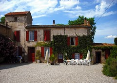 Domaine de Barthe Gites, Douzens, France (vic_burton) Tags: door windows red vacation plants house holiday france building home window wall umbrella buildings french table vineyard vines chairs entrance ivy vine courtyard parasol shutters aude southoffrance gravel