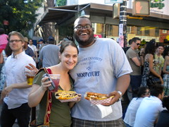 Bacon & Amy show off their sandwiches (kathleenbarber) Tags: nyc brooklyn streetfair bastilleday