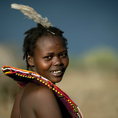 Pokot girl with a giant beaded necklace and a feather on the head - Kenya (Eric Lafforgue) Tags: africa portrait people smile face kenya african culture tribal human tribes afrika remote tradition tribe ethnic tribo visage afrique ethnology tribu eastafrica qunia 7587 lafforgue ethnie  qunia infinestyle    kea    a