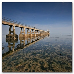 Reflections. Bembridge Lifeboat Station, Isle of Wight, UK. (s0ulsurfing) Tags: ocean blue sea sky holiday seascape tourism beach water lines composition plane square landscape island coast march pier boat holidays skies quiet peace jetty sightseeing wide perspective shoreline wideangle pebbles tourist calm ufo explore coastal filter shore vectis isleofwight solent vista coastline grad landschaft frontpage isle 2009 diffused squared sights wight attraction mellow subtle hmb bembridge 10mm eow sigma1020 nd4 s0ulsurfing visitorattraction bembridgelifeboatstation eastwight bembridgelifeboat mondocafeclub isleofwightattractions bembridgebay isleofwightattraction welcomeuk