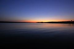 Lac La Hache (Cariboo Finn) Tags: blue sunset red orange lake beach water yellow island tripod gitzo sigma1020 nikond40
