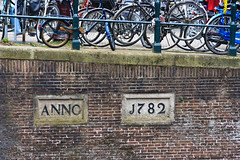 Anno 1782 (Cameron Booth) Tags: netherlands amsterdam bicycle sign wall fence typography europe vehicle nl northholland