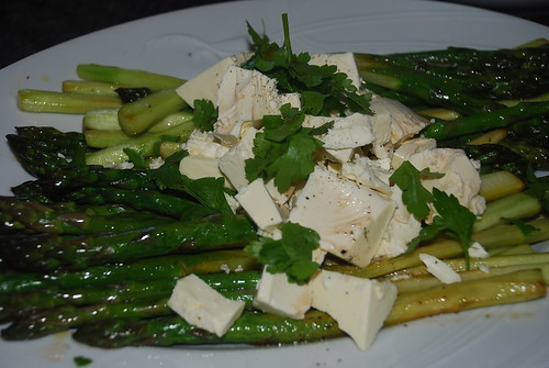 Stir fresh asparagus with lemon sauce and feta
