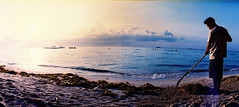 early morning job (darkcanopy) Tags: morning travel blue panorama film beach yellow analog 35mm photography lomo xpro lomography crossprocessed crossprocess horizon 28mm philippines wide earlymorning wideangle slide panoramic photograph crossprocessing bohol swinglens 28 135 agfa ph expired job agfaprecisa  analogphotography f28 horizon202 lomograph panglao  agfachrome xprod agfactprecisa 120degrees kmz lomomanila 135film horizonperfekt lomohorizon panglaobeach 135format xproing