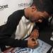 Kid Cudi signing autographs