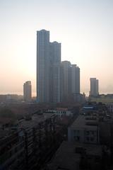 Wuhan (arnd Dewald) Tags: china light shadow sunrise hotel licht highrise  wuhan sonnenaufgang schatten hubei marcopolo hochhaus   hankou   samebutdifferent arndalarm zhnggu whn hbi img1193v5r11klein ductours lanlinglu
