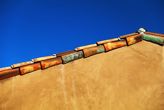 Against the Sky (studioferullo) Tags: abstract architecture art beauty bright building colorful colors contrast design detail downtown edge gold house light minimalism outdoor outside perspective pattern pretty scene serene tranquil sky study sunlight sunshine street texture tone weathered world arizona tubac roof tile wall brown blue lines diagonal adobe stucco plaster green ocher ochre yellow