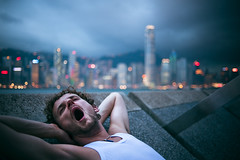 Yawn (TGKW) Tags: city portrait people white storm man beautiful skyline clouds hair hongkong evening bokeh dusk sleepy curly tired promenade vest gesture sha rik tsim tsui yawning 2769