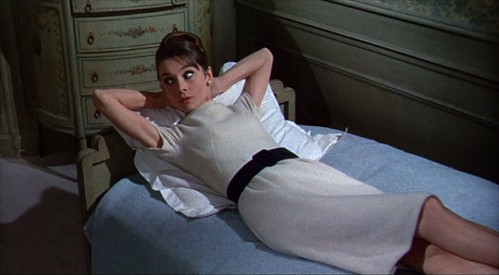 charade_lyingonbed_whitedress