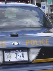NY State Police squad car is running & keys are in the ignition; no troopers are in evidence