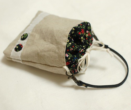 Petit pouch with leather strap