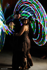 Hoops and Feathers (naturalturn) Tags: california longexposure light party portrait usa night hoop berkeley dance couple glow dancing andrew double spinning hoops kandice hooping flowspace doublehoop glowhoop lighthoop image:rating=5 lighthooping glowhooping image:id=071935 andrewkaus kandicekorveskaus