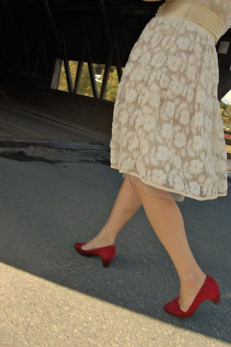 bride in lace dress and red shoes