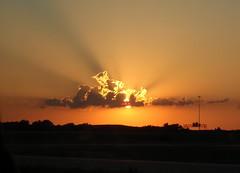 Kansas Sunset (mooshrimp) Tags: light sunset summer sky orange sun beautiful clouds glow bright kansas pointandshoot beams lightbeams fromacar