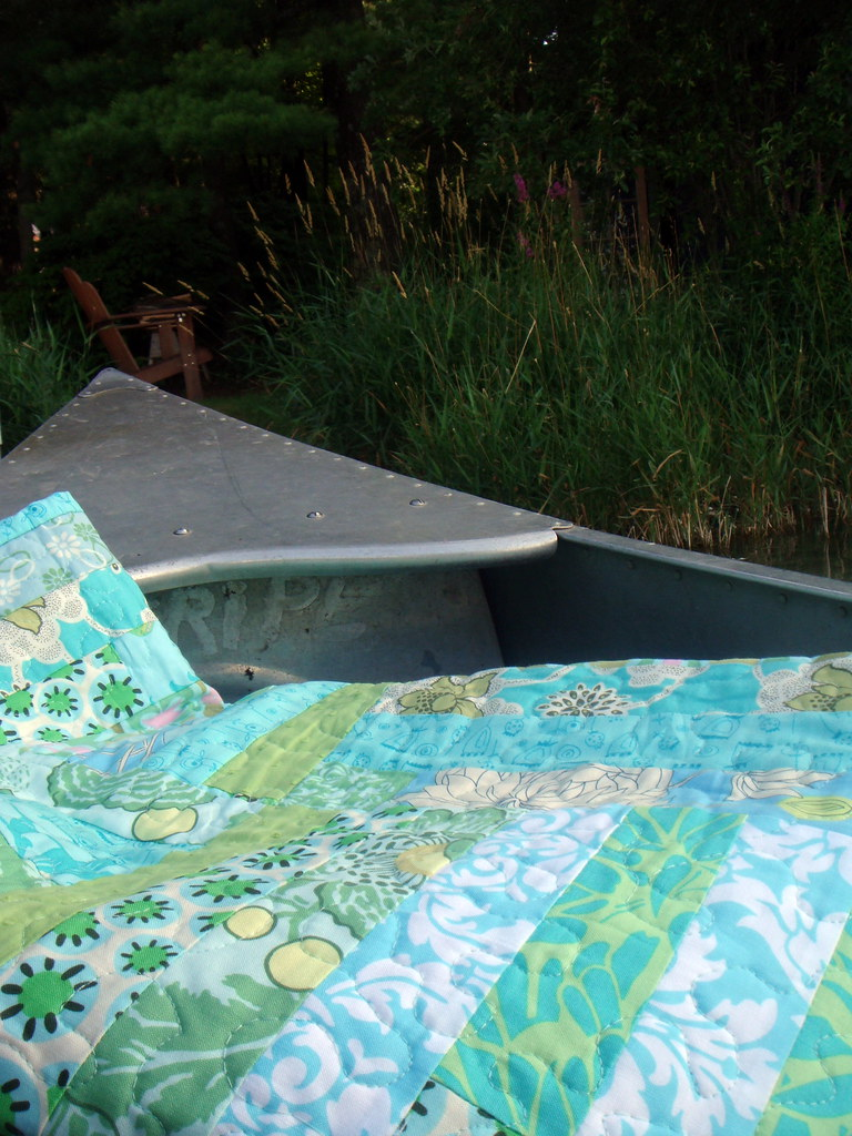 blue green strip quilt in a canoe (?!?)