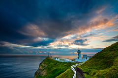 Sunrise at Bitou Cape Lighthouse  (olvwu | ) Tags: ocean longexposure morning light sea sky cliff cloud lighthouse mountain rock sunrise dawn cloudy hiking taiwan trail taipei seashore rueifang taipeicounty jungpangwu oliverwu oliverjpwu bitoucape olvwu rueifangtownship jungpang taiwanphotographers platinumpeaceaward bitoucapelighthouse