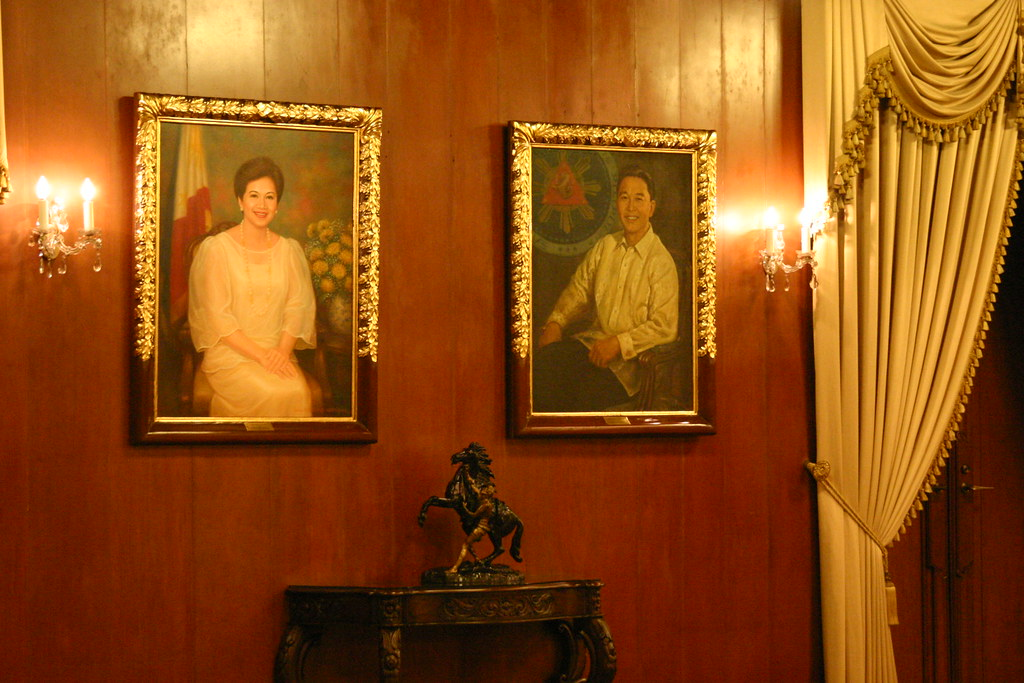 Paintings of late presidents Cory Aquino and Ferdinand Marcos.
