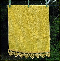 yellow towel with crochet lace border