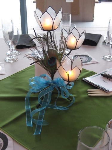 Wedding centerpieces with peacock feathers