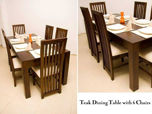 this is a teak dining table with 6 chairs made by alankara gallery