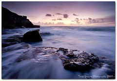 Surf at sunrise - Winspit (TDR Photographic) Tags: uk morning light sea england sky water sunrise canon landscape dawn coast movement rocks surf waves tide dorset quarry contrejour daybreak ndfilter winspit jurassiccoast eos5d dorsetcoastpath