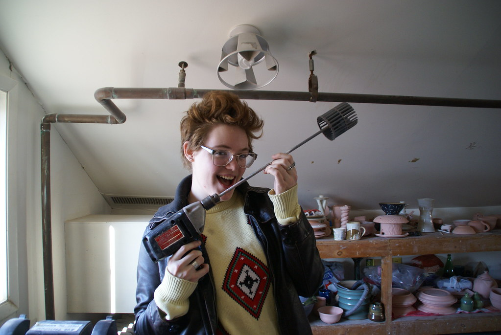 A student holds a drill