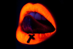 Christianity #1 (Rekanyari) Tags: orange art beauty fashion tongue closeup mouth christ cross bright symbol artistic teeth uv religion lips blacklight christianity uvlight fluxmagazine rekanyari