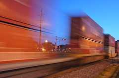 see-through (christiaan_25) Tags: blue summer sky orange blur speed train lights evening crossing transport traintracks tracks fast 71 explore wires shipping containers wheaton shippingcontainers wheatonil 1stplacef2fchallenge 28june2009