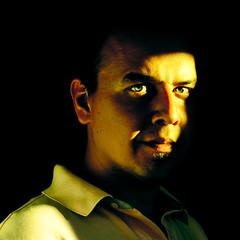 (Georgios Karamanis) Tags: light shadow portrait selfportrait man home me face yellow self dark square eyes sp ear uppsala explored karamanis