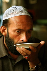 Tea & Time :) (Amir Mukhtar Mughal | www.amirmukhtar.com) Tags: pakistan light people man male canon beard drops time tea watch drinking plate drop ring cap amir wristwatch kaghan sip pathan naran mughal mughals balakot amirmukhtar