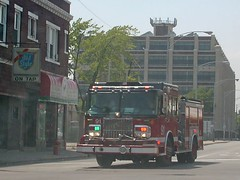 Chicago Fire Department responding to a call on West Belmont Avenue. Chicago Illinois. June 2007.