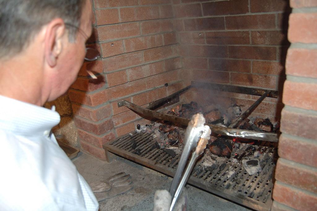 Chuck prepares the steaks
