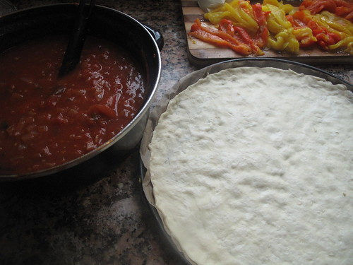 Pizza base and tomato sauce