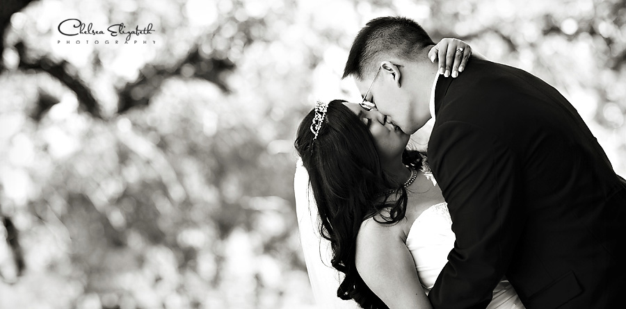 black and white bride and groom portrait kiss picture