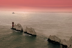 Needles at dusk (fiendicus) Tags: uk pink light sunset sea england cliff lighthouse house water bay boat chalk rocks europe waves britain cliffs shore needles isle wight