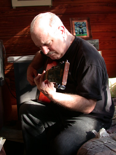Uncle Joe, playing guitar