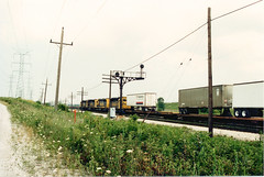 Eastbound Atchinson, Topeka & Santa Fe piggyback train passing through Nerska Junction. Chicago Illinois. May 1990.