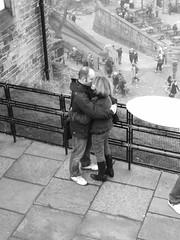 a kiss in the Castle (byronv2) Tags: blackandwhite bw woman man black castle monochrome scotland blackwhite hug kiss couple edinburghcastle romance romantic peoplewatching snog