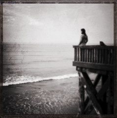 the fluent sea (kindersnap!) Tags: ocean sea sky blackandwhite bw woman water clouds pier blurry whitewater waves tide horizon dreams