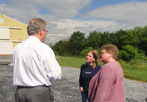 Thomas Williams, Pennsylvania Rural Development State Director, talks about the USDA Rural Energy for America Program with Roxanne Molnar, funding recipient (center) and Deputy Under Secretary for Rural Development Cheryl Cook.  REAP funding enabled Molnar Farms to install computer-controlled radiant heaters to reduce energy costs.  Cook and Williams toured the farm earlier this month.